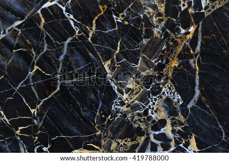 Gold and white patterned structure of dark gray marble pattern texture for design.