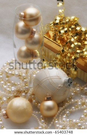 Gold and white trinkets, gift and holiday baubles