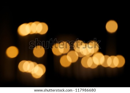 Gold and Yellow Festive Christmas background. Elegant abstract background with bokeh defocused lights and stars