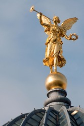 Gold angel on the University building (Dresden, Germany)