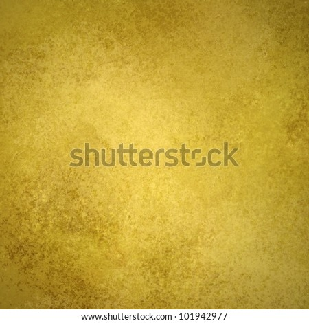 gold background or old gold paper with warm rich yellow and brown colors with vintage grunge background texture like gold wall wallpaper or plaster cement for weddings invitations or anniversary