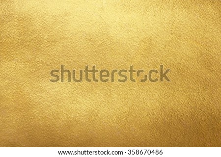 Gold background. Rough golden texture. Luxurious gold paper template for your design.