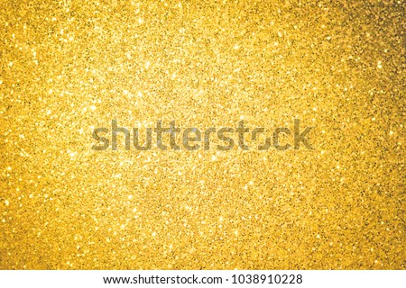 Gold background shiny glitter texture brilliant pattern. Beauty crystal abstract for holiday christmas with bokeh light golden.