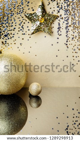Gold background, sparkling background with  golden star, sparkles, christmas tree decorations with mirror reflection #1289298913