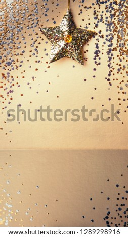 Gold background, sparkling background with  golden star, sparkles, christmas tree decorations with mirror reflection #1289298916