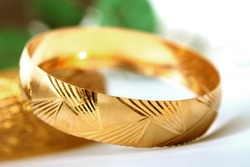 Gold bangle bracelets concept photo