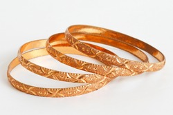 Gold bangle isolated on white background. Celebrity lifestyle accessories. Crazy rich lifestyle. Model Accessories