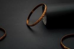 Gold bangle on black background