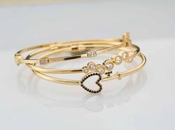 Gold bangle on white background