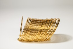 Gold bangles by women hand. Traditional gold bangles stacked