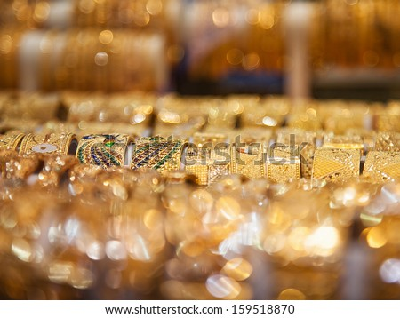 Gold bangles in a Dubai gold souk. United Arab Emirates
