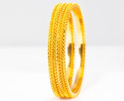 Gold bangles isolated on white background - wedding / Traditional gold bangles