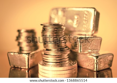 Gold bars and stack of gold coins. Background for finance banking concept. Trade in precious metals. Stock photo ©