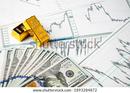 gold bars at dollar bills, rise and fall of gold exchange rate against dollar financial concept diagram showing changes in price of gold. Concept of inflation