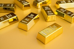 Gold bars or bullion on yellow background. Financial, global world economic or gold trading in commodity market concept.