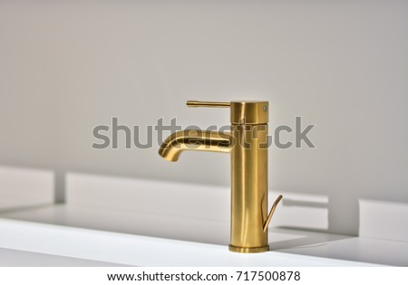Gold bathroom faucet. Modern bathroom faucet #717500878