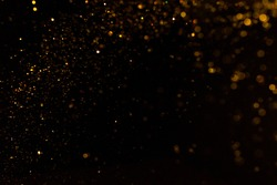 Gold bokeh of lights on black background