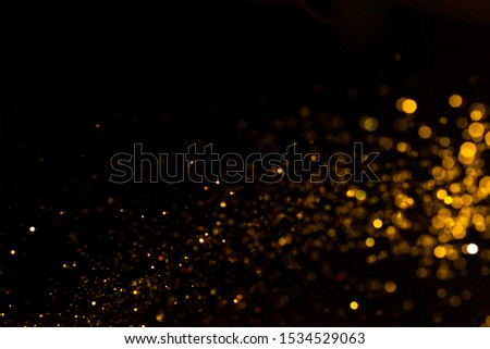 Gold bokeh of lights on black background #1534529063