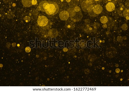 gold bokeh of lights on black background