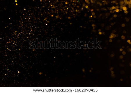 Gold bokeh of lights on black background stock photo