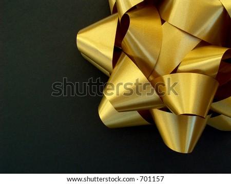 gold bow in upper right corner