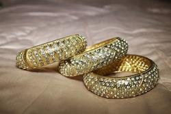 gold bracelet studded with diamonds