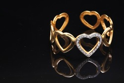 gold bracelet with hearts