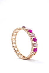 gold bracelet with pink stones on white background