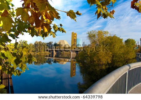 Gold Bridge framed by autumn leaves
