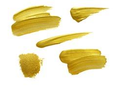 Gold brush stokes set isolated on white background