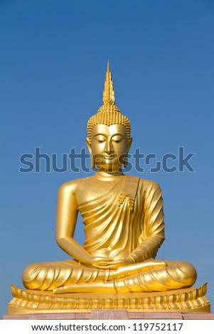 Gold buddha statue with blue sky