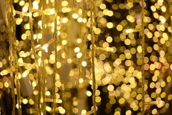Gold bukeh shine by series wired light blub decorating for celabrate the night of Xmas