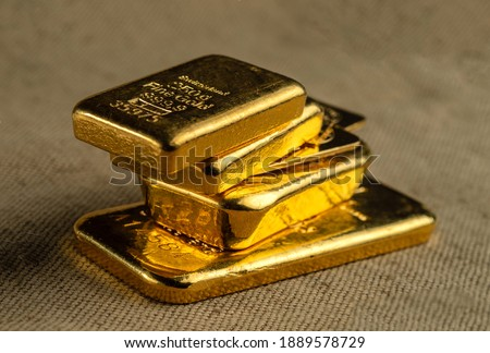 Gold bullion. A stack of gold bars of various weights. Selective focus