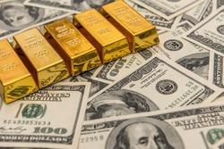 gold bullion bars on usd money bills. Success concept. Investment
