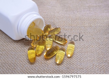 Gold capsule omega 3 pills capsules. healthy diet concept