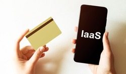 gold card and phone with text disaster recover plan IaaS in the female hands