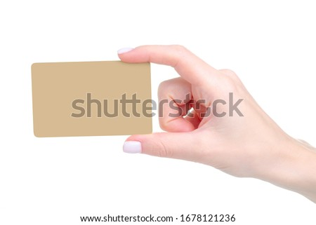 Gold card in hand finane on white background isolation Imagine de stoc ©