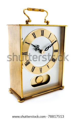 Gold carrige clock isolated on white