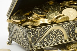 gold casket and gold coins on a white background