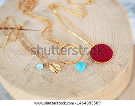 gold chain necklaces with turquoise stones - red stone - gold shell necklace - greek jewelry Photo stock ©