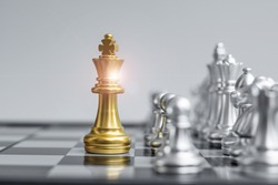 Gold Chess king figure on Chessboard against opponent or enemy. Strategy, Conflict, management, business planning, tactic, politic, communication and leader concept