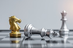 gold Chess Knight figure stand out from crowd of enermy or opponent during chessboard competition. Strategy, Success, management, business planning, disruption, win and leadership concept