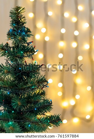 Gold Christmas background of de-focused lights garland with decorated tree #761597884