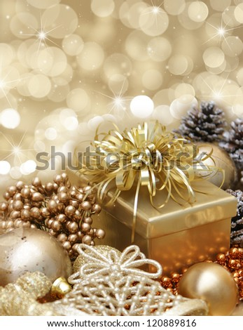 Gold Christmas background with gift, decorations on bokeh lights - stock photo