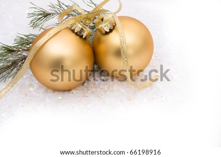 Gold christmas balls on a snow background, christmas time