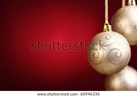 Gold christmas balls on red background