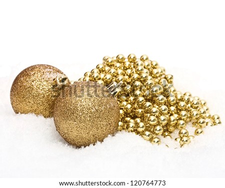 gold christmas balls with snow isolated on white