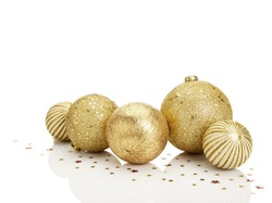 Gold Christmas balls with stars on white background. Copy Space.
