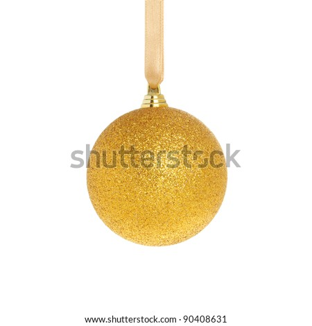 Gold Christmas bauble hanging from a ribbon isolated against white