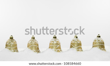 Gold Christmas Bell Decorations and Snow
